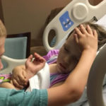 The last caress of a child to his little sister