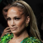 "JLo on the catwalk at 50 is a hymn to femininity that fears no time and ""imperfections"""