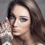 Coloring hair with henna: benefits and ways of use
