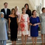 NATO Summit: The husband of the gay premier of Luxembourg poses with the First Lady