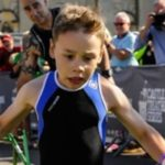 At 8 he challenges paralysis and competes in triathlon