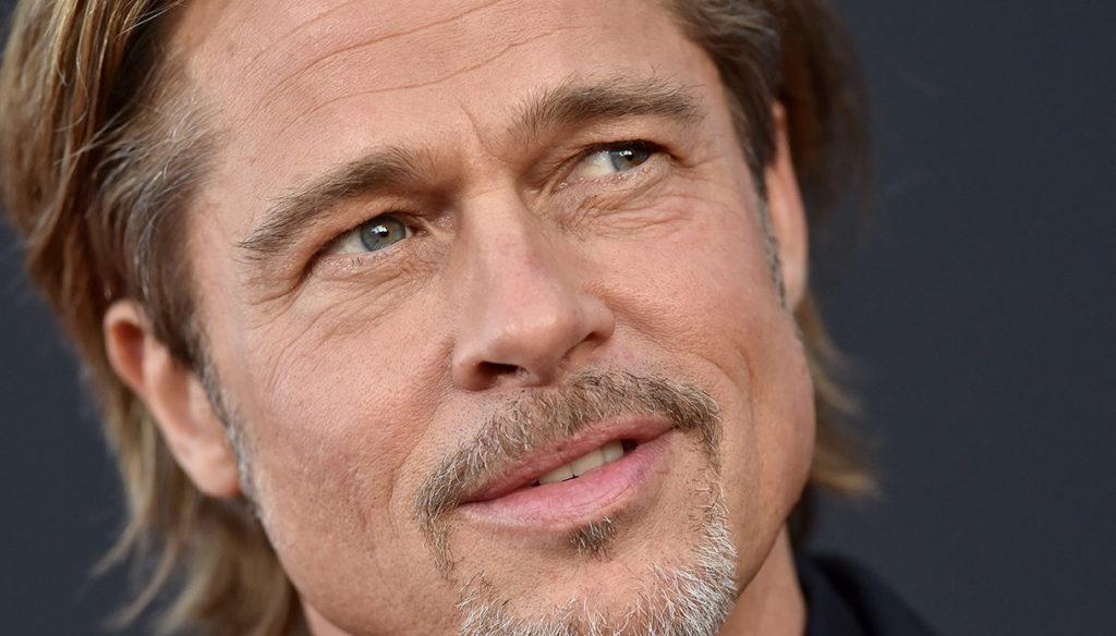 Brad Pitt, lo champagne è già un successo. Ma una donna gli fa causa