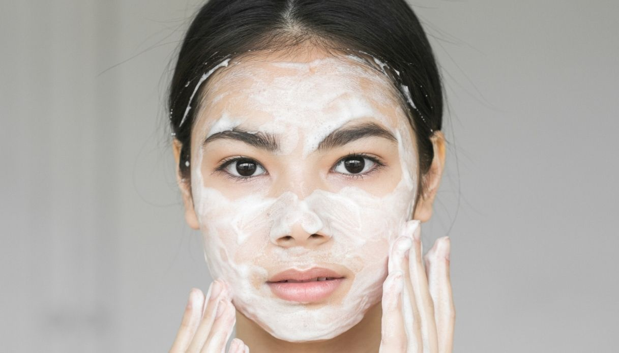 asian girl with soap and foam on her face