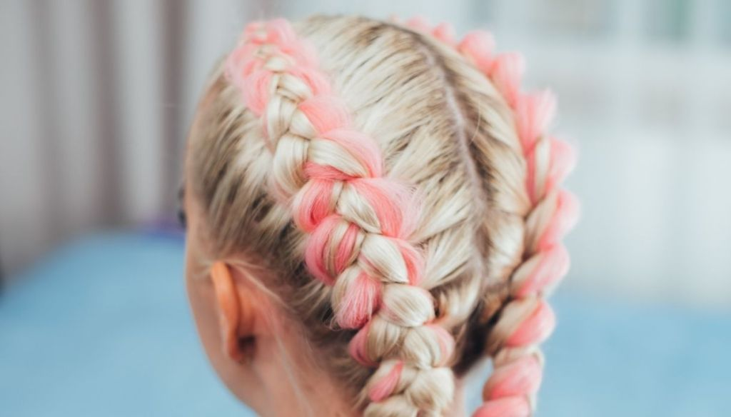 Blonde girl from behind with pink boxer braids tracks