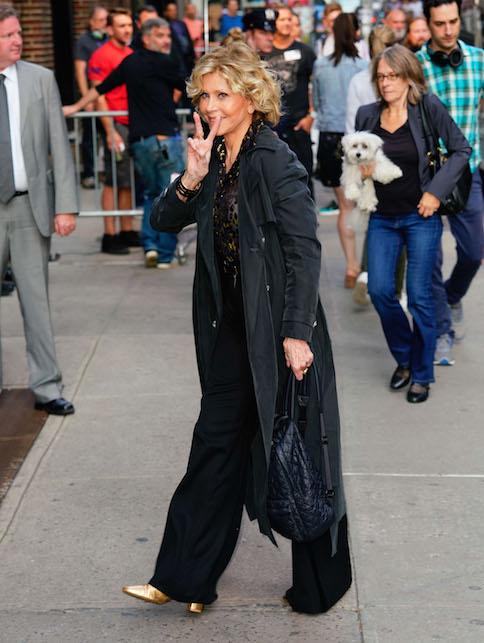 Jane Fonda in black and gold
