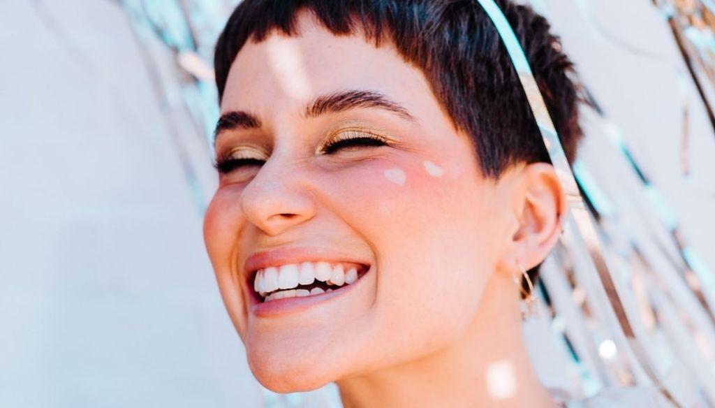 smiling girl short hair pink blush makeup