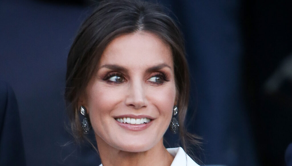 Letizia of Spain, the enveloping tuxedo dress at the gala. And then you get over it with the turquoise sheath dress