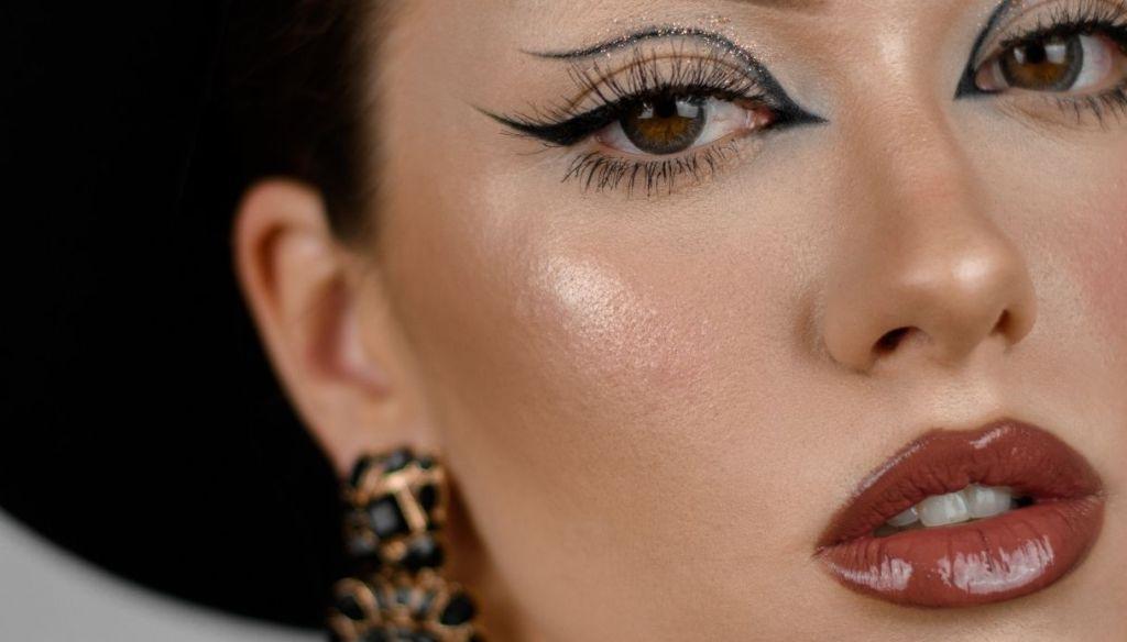 girl full lips brown lipstick graphic eyeliner