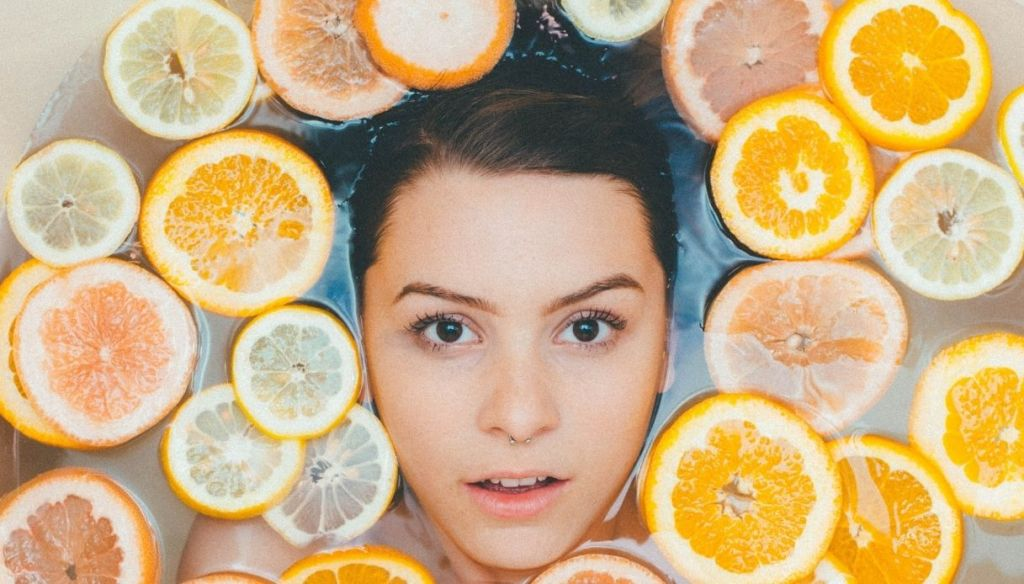 girl piercing septum oranges