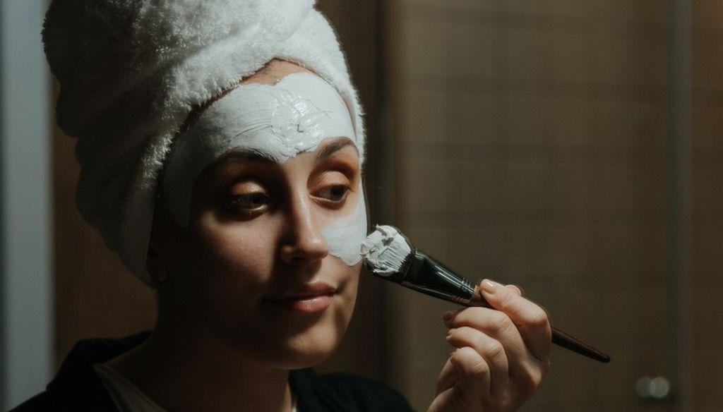 hair turban girl applies face mask