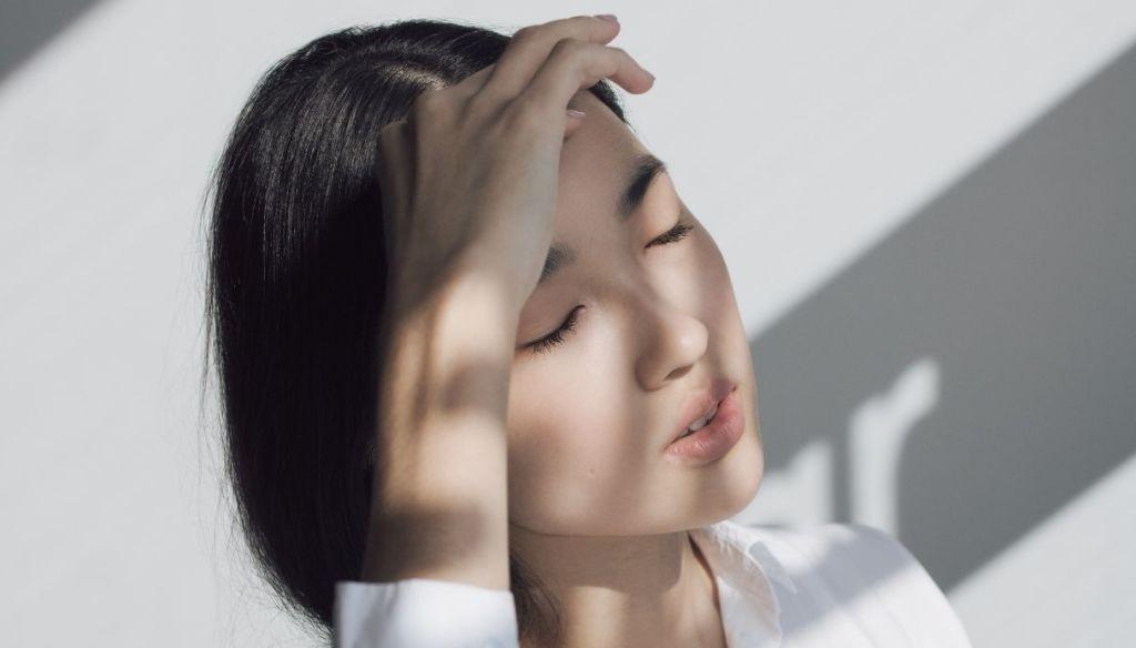 brunette asian girl closed eyes pale skin