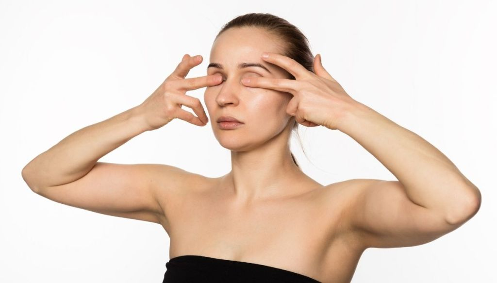 woman eye contour cream massage